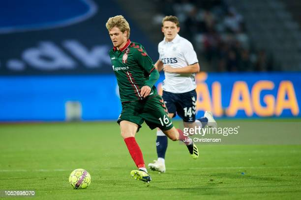 Magnus Christensen of AaB Aalborg controls the ball during the Danish Superliga match between AGF Arhus and AaB Aalborg at Ceres Park on October 21...