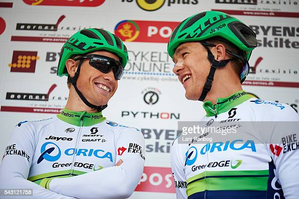 Magnus Cort Nielsen and Christopher Juul Jensen of ORICA-GreenEDGE speaks to each other prior to the Elite Men Road Race Championships on day three...