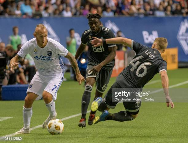 Magnus Eriksson of the San Jose Earthquakes Alphonso Davies of the Vancouver Whitecaps and Brett Levis of the Vancouver Whitecaps at BC Place on...