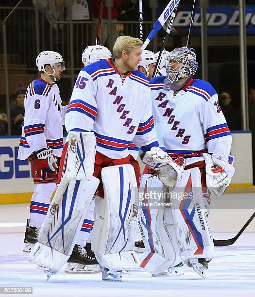 Magnus Hellberg and Henrik Lundqvist of the New York Rangers skate off the ice following a 32 victory over the Anaheim Ducks at Madison Square Garden...