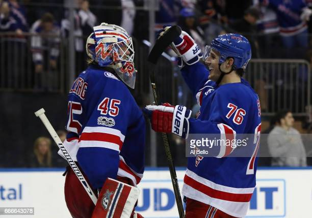 Magnus Hellberg of the New York Rangers celebrates his first NHL win with Brady Skjei against the Pittsburgh Penguins during their game at Madison...