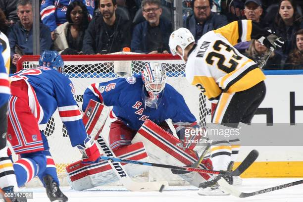 Magnus Hellberg of the New York Rangers tends the net against Scott Wilson of the Pittsburgh Penguins at Madison Square Garden on April 9 2017 in New...