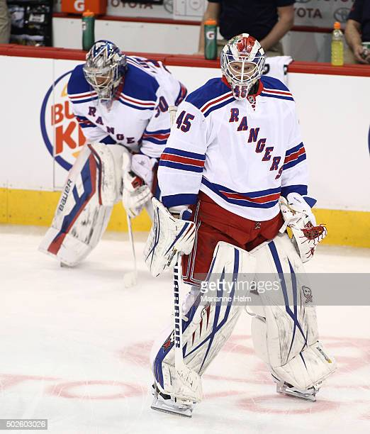 Magnus Hellberg skates down the ice in front of Henrik Lundqvist during warmup before an NHL game against the Winnipeg Jets at the MTS Centre on...