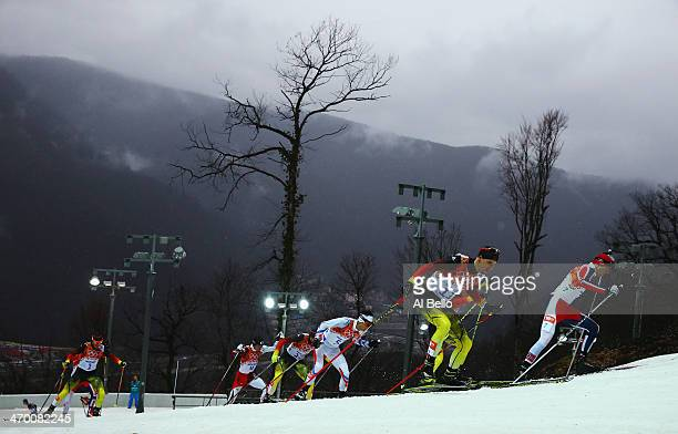 Magnus Hovdal Moan of Norway and Bjoern Kircheisen of Germany lead the pack the Nordic Combined Men's 10km Cross Country during day 11 of the Sochi...
