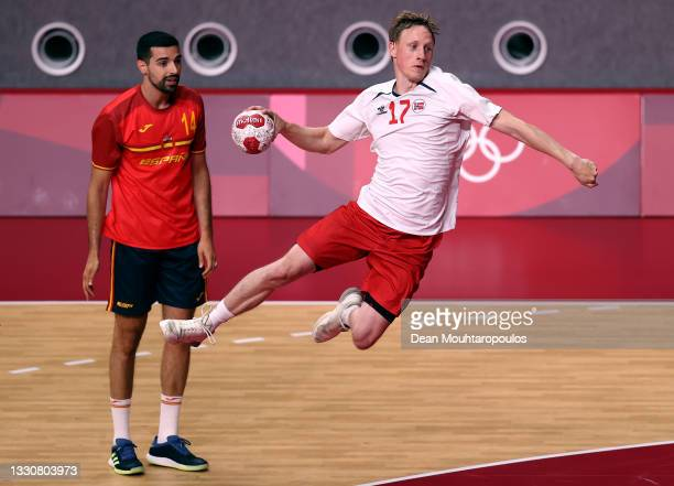Magnus Joendal of Team Norway shoots at goal whilst Ferran Sole Sala of Team Spain looks on during the Men's Preliminary Round Group A match between...