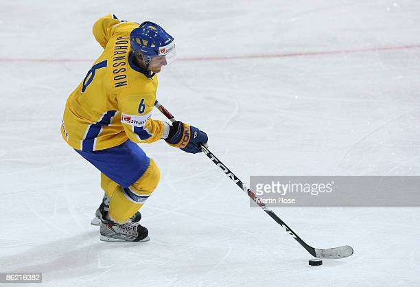 Magnus Johansson of Sweden runs with the puck during the IIHF World Ice Hockey Championship preliminary round, group C match between Sweden and...