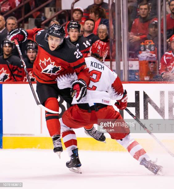 Magnus Koch of Denmark delivers a bodycheck to Morgan Frost of Canada in Group A hockey action of the 2019 IIHF World Junior Championship action on...
