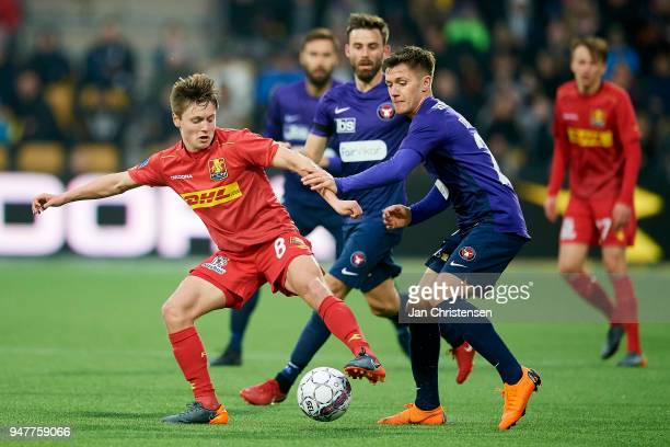 Magnus Kofod Andersen of FC Nordsjalland and Mikkel Duelund of FC Midtjylland compete for the ball during the Danish Alka Superliga match between FC...