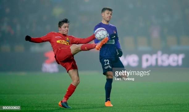 Magnus Kofod Andersen of FC Nordsjælland and Mikkel Duelund of FC Midtjylland compete for the ball during the Danish Alka Superliga match between FC...