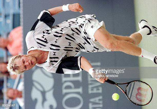 Magnus Larsson of Sweden returns a shot to Wayne Ferreira of the Republic of South Africa 02 September in their fourth round match at the US Open in...