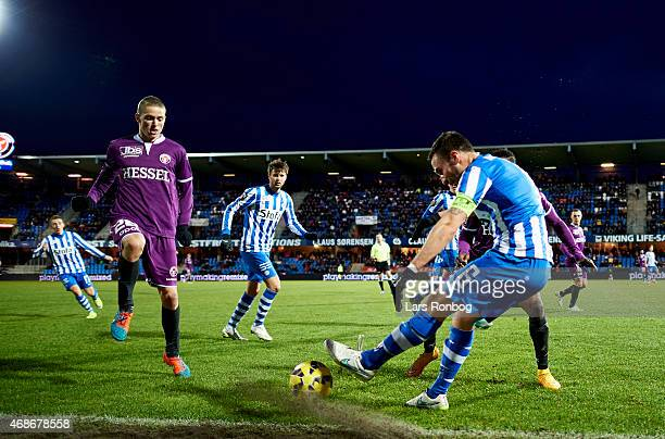Magnus Lekven of Esbjerg FB and Andre Romer of FC Midtjylland compete for the ball during the Danish Alka Superliga match between Esbejrg fb and FC...