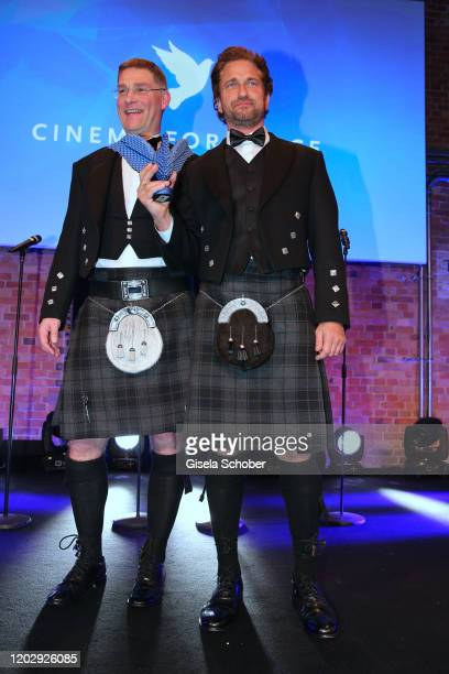 Magnus MacFarlane Barrow and Gerard Butler during the Cinema For Peace Gala at Westhafen Event & Convention Center on February 23, 2019 in Berlin,...