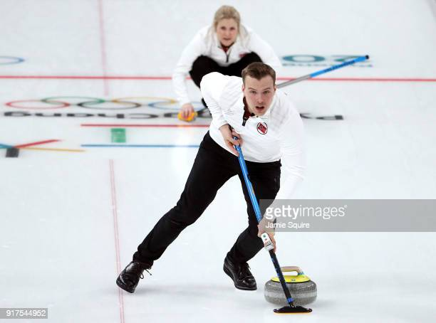 Magnus Nedregotten of Norway sweeps against Olympic Athletes from Russia during the Curling Mixed Doubles Bronze Medal Game on day four of the...