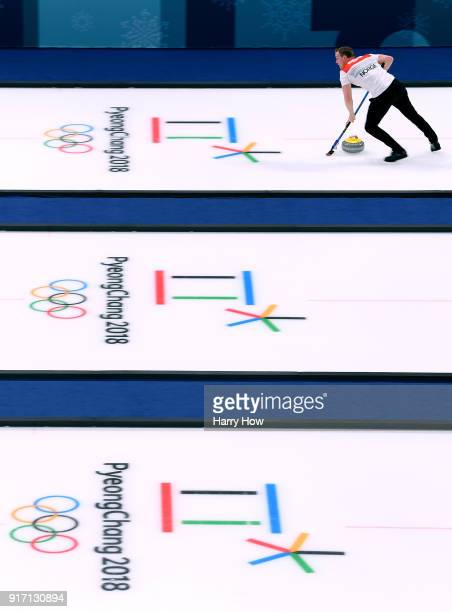 Magnus Nedregotten of Norway sweeps in an 84 loss to Canada during the Curling Mixed Doubles SemiFinals Session One at Gangneung Curling Centre on...