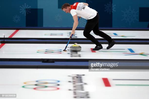 Magnus Nedregotten of Norway sweeps the ice against Canada in the Curling Mixed Doubles Round Robin Session 1 during the PyeongChang 2018 Winter...