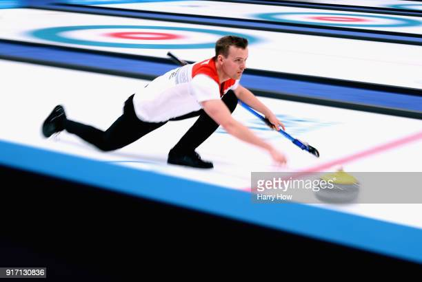 Magnus Nedregotten of Norway throws his rock in an 84 loss to Canada during the Curling Mixed Doubles SemiFinals Session One at Gangneung Curling...