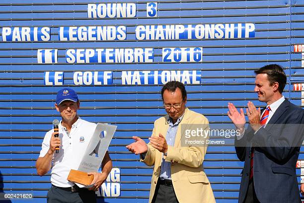 Magnus P Atlevi of Sweden , Pascal Grizot, Director of Ryder Cup France , David MacLaren, Head of European Seniors Tour pose with the trophy after...