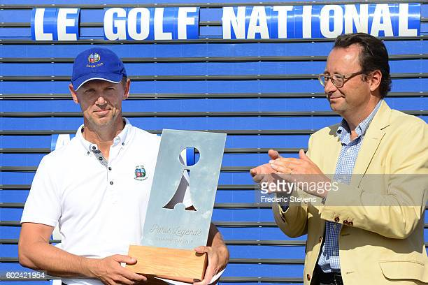 Magnus P Atlevi of Sweden , Pascal Grizot, Director of Ryder Cup France pose with the trophy after the final round of the Paris Legends Championship...
