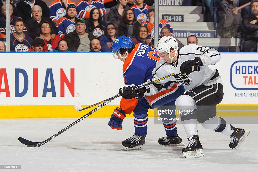 Magnus Paajarvi #91 of the Edmonton Oilers skates against Slava Voynov #26 of the Los Angeles Kings during an NHL game at Rexall Place on February 19, 2013 in Edmonton, Alberta, Canada.