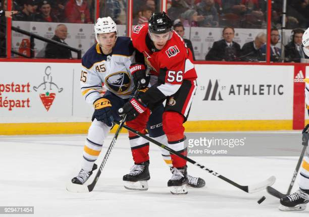 Magnus Paajarvi of the Ottawa Senators battles for position against Brendan Guhle of the Buffalo Sabres at Canadian Tire Centre on March 8 2018 in...
