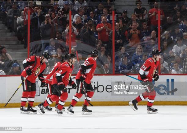 Magnus Paajarvi of the Ottawa Senators celebrates his second period goal against the Toronto Maple Leafs with teammates Chris Tierney Thomas Chabot...