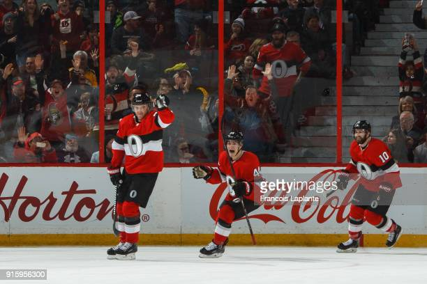 Magnus Paajarvi of the Ottawa Senators celebrates his second period goal along with teammates JeanGabriel Pageau and Tom Pyatt against the Nashville...