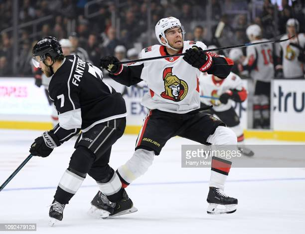 Magnus Paajarvi of the Ottawa Senators eludes a check from Oscar Fantenberg of the Los Angeles Kings during the first period at Staples Center on...