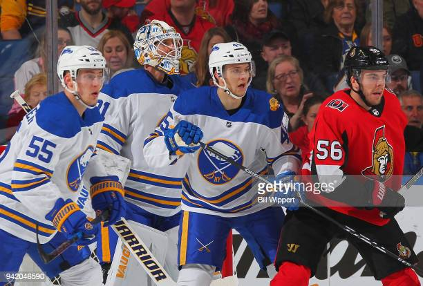 Magnus Paajarvi of the Ottawa Senators is defended by Rasmus Ristolainen Chad Johnson and Brendan Guhle of the Buffalo Sabres during an NHL game on...