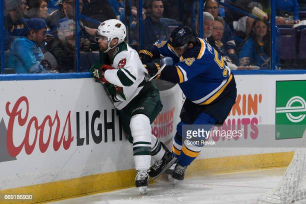 Magnus Paajarvi of the St Louis Blues checks Nate Prosser of the Minnesota Wild in Game Three of the Western Conference First Round during the 2017...