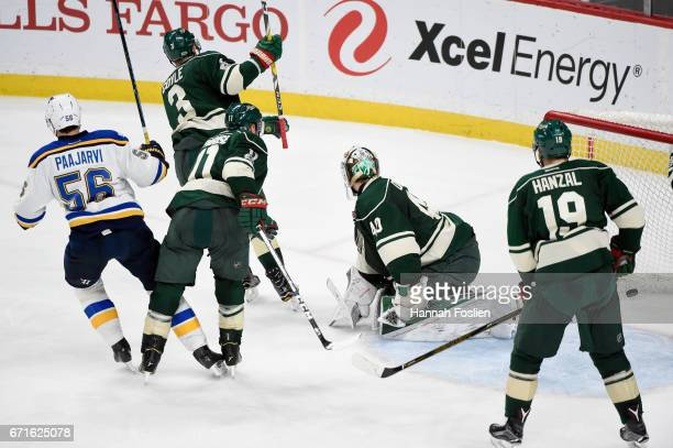 Magnus Paajarvi of the St Louis Blues scores the gamewinning goal in overtime as Charlie Coyle Zach Parise Devan Dubnyk and Martin Hanzal of the...