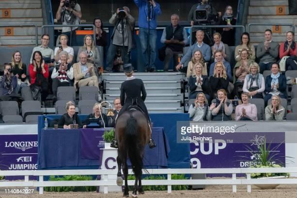 Magnus Ringmark head of the jury and the audience watch as German dressage rider Helen Langehanenberg tries to stop her horse Damsey FRH from walking...