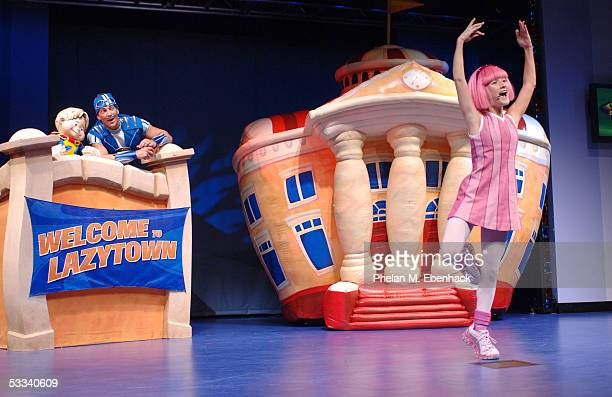 Magnus Scheving center Ziggy left and Julianna Rose Mauriello from the Nick Jr series LazyTown celebrate the kickoff of the LazyTown Live Tour at the...