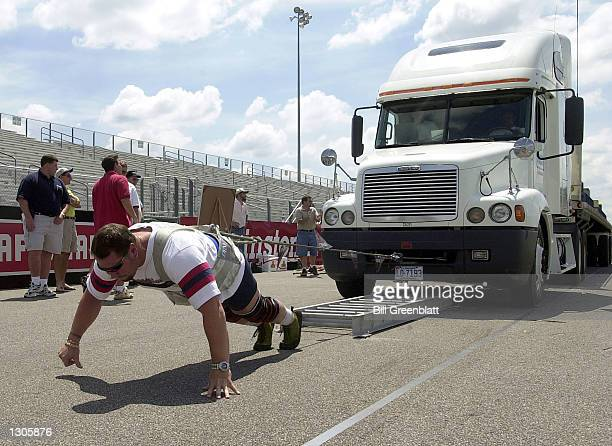 Magnus Ver Magnusson fourtime winner of the World''s Strongest Man Competition pulls a 60 thousandpound tractor trailer truck during a practice pull...