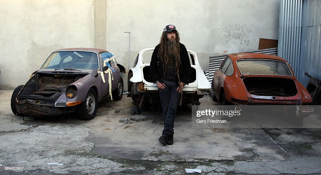 Magnus Walker sits in the \'chop shop\' restoration area (with parts ...