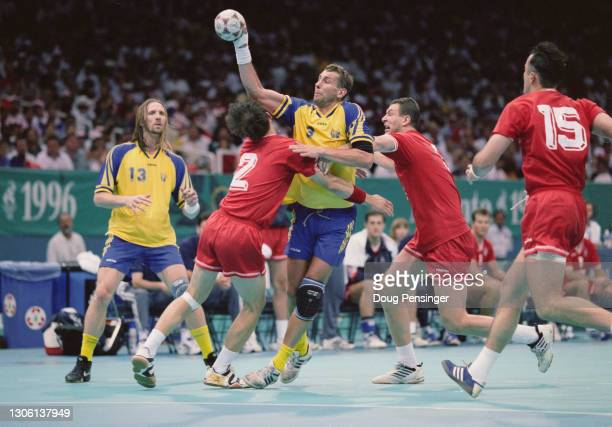 Magnus Wislander, Center back and Line player for Sweden shoots for goal during the final of the Men's Olympic Handball Tournament against Croatia at...