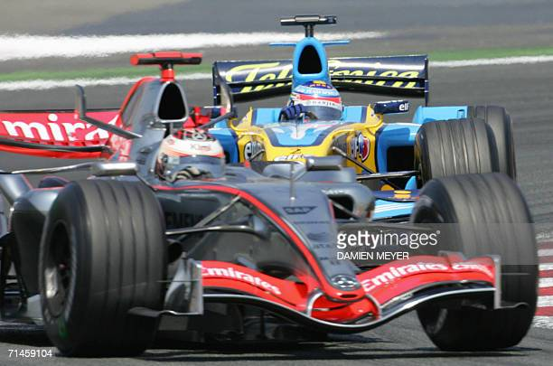Finnish McLarenMercedes driver Kimi Raikkonen steers his car ahead of Italian Renault driver Giancarlo Fisichella on the Nevers MagnyCours racetrack...