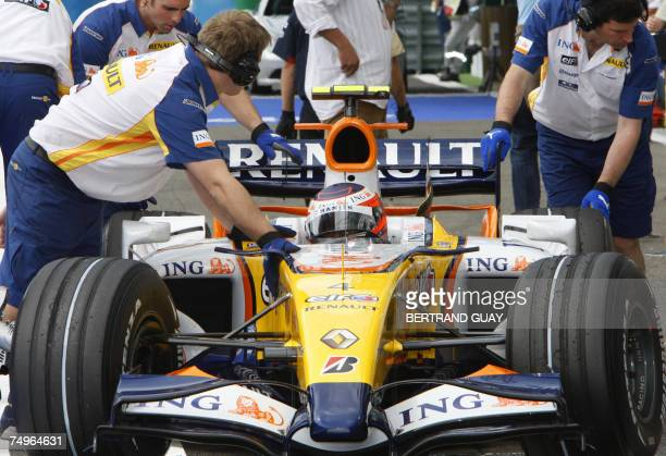 Finnish Renault driver Heikki Kovalainen enters the pits of the Nevers Magny-Cours racetrack, 30 June 2007, during the third practise session of the...