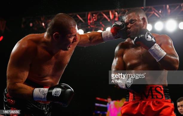 Magomed Abdusalamov punches Mike Perez during their Heavyweight fight at The Theater at Madison Square Garden on November 2, 2013 in New York City.