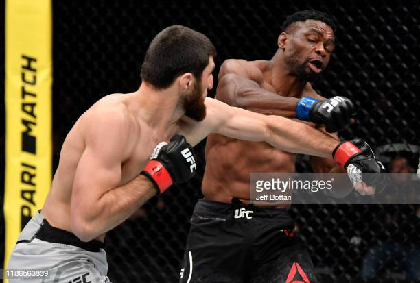 Magomed Ankalaev of Russia punches Dalcha Lungiambula of South Africa in their light heavyweight bout during the UFC Fight Night event at CSKA Arena...