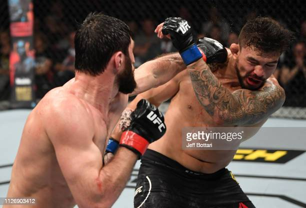Magomed Ankalaev of Russia punches Klidson de Abreu of Brazil in their light heavyweight bout during the UFC Fight Night event at O2 Arena on...