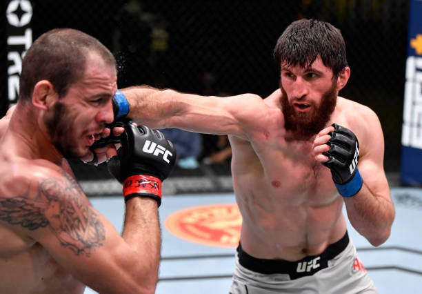 Magomed Ankalaev of Russia punches Nikita Krylov of the Ukraine in a light heavyweight bout during the UFC Fight Night event at UFC APEX on February...