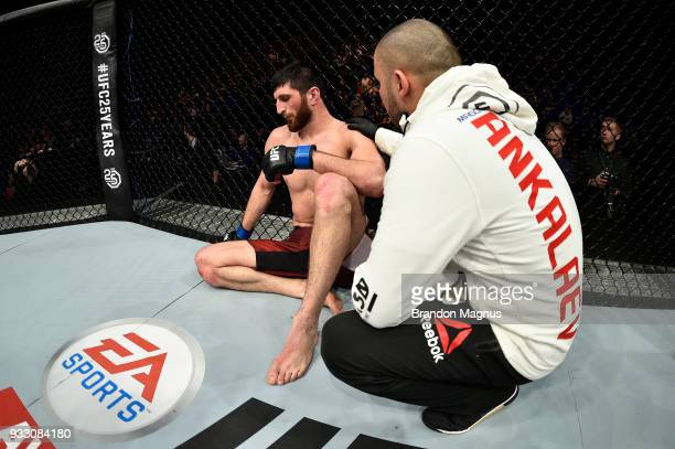 Magomed Ankalaev reacts in his corner after being defeated by submission against Paul Craig of Scotland in their light heavyweight bout inside The O2...