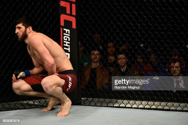 Magomed Ankalaev rests after receiving a low knee to the groin area by Paul Craig of Scotland in their light heavyweight bout inside The O2 Arena on...