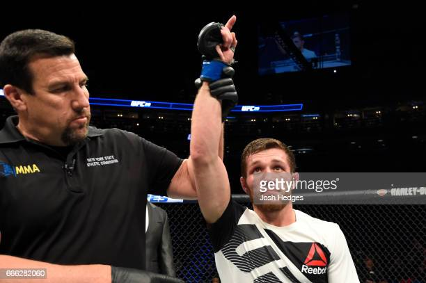 Magomed Bibulatov of Russia is awarded victory by unanimous decision over Jenel Lausa of the Philippines in their flyweight bout during the UFC 210...