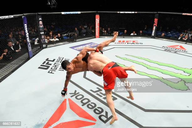 Magomed Bibulatov of Russia takes down Jenel Lausa of the Philippines in their flyweight bout during the UFC 210 event at KeyBank Center on April 8...