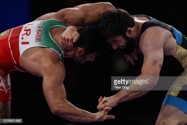 Magomed Musaev of Kyrgyzstan and Alireza Karimimachiani of Iran during their men's wrestling freestyle 97kg godlen medal match on day one of the...