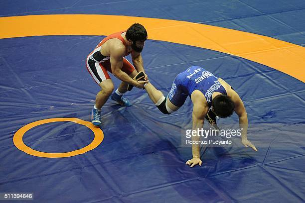Magomed Musaev of Kyrgyzstan competes against Koki Yamamoto of Japan in the Men's Freestyle Senior 97 kg quarterfinal match during the 2016 Wrestling...