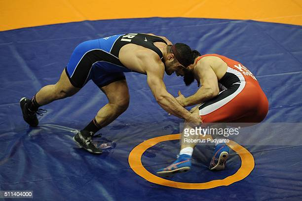 Magomed Musaev of Kyrgyztan competes against Reza Mohammad Ali Yazdani of Iran in the Men's Freestyle Senior 97 kg final match during the 2016...