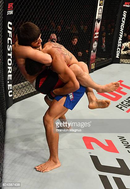 Magomed Mustafaev of Russia attempts to secure a guillotine choke submission against Kevin Lee in their lightweight bout during the UFC Fight Night...