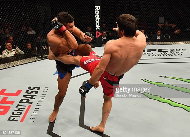 Magomed Mustafaev of Russia kicks Kevin Lee in their lightweight bout during the UFC Fight Night at the SSE Arena on November 19 2016 in Belfast...
